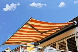retractable-vs-fixed-awning-300x200